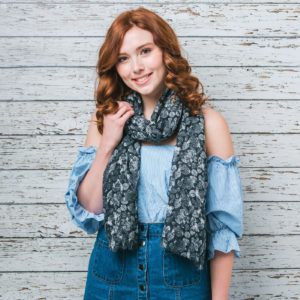 Lousie - Soft scarf with a leaf print design finished with a feathered edge