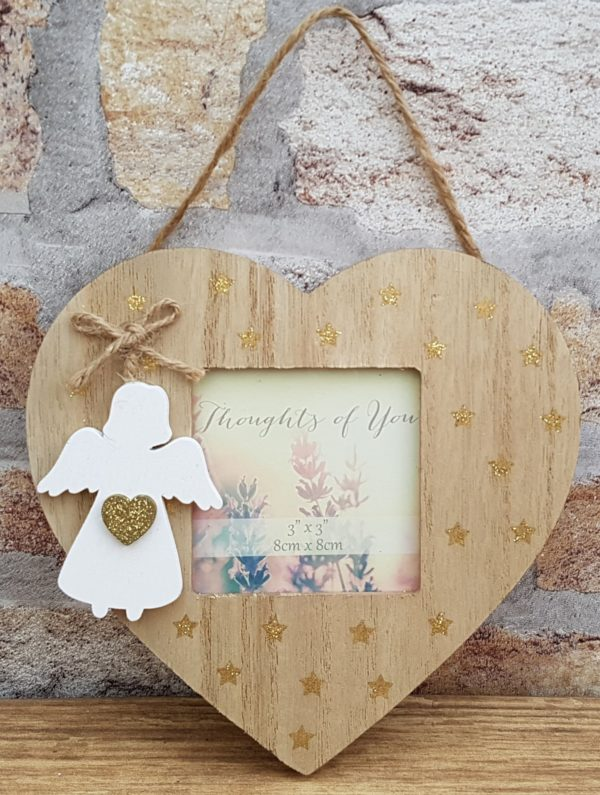 heart frame with angel