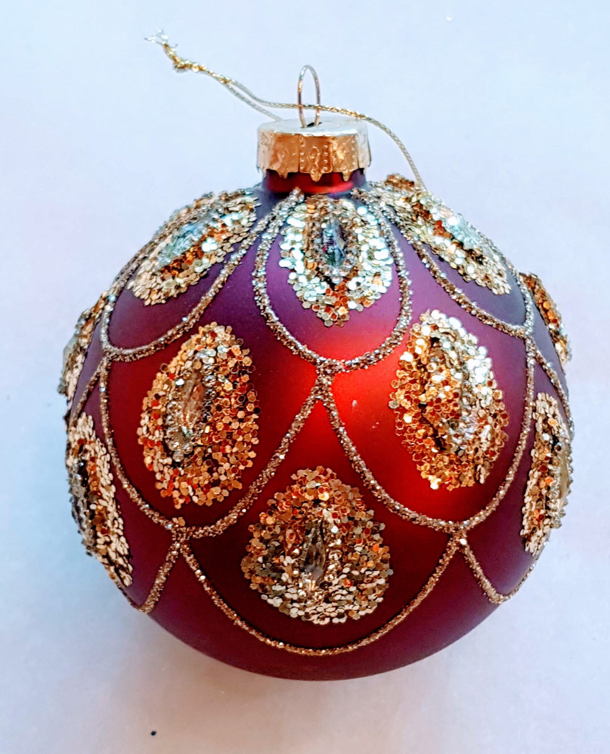 red bauble with gold swag